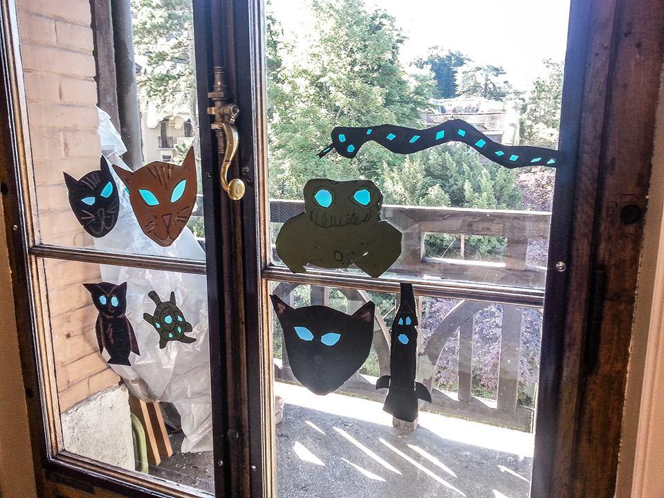 suncatchers in window, geneva women's club